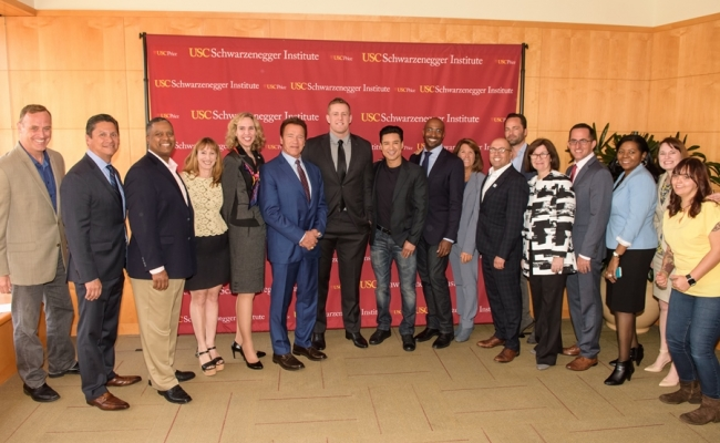 From left: Matt Iseman, Chancellor Eloy Oakley, Gerard Robinson, Jodi Grant, Mayor Jennifer Roberts, Governor Arnold Schwarzenegger, JJ Watt, Mario Lopez, Van Jones, Bonnie Reiss, Ben Paul, Micheal Be